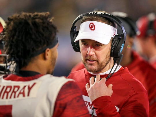 Nov 23, 2018; Morgantown, WV, USA; Oklahoma Sooners head coach Lincoln Riley talks with Oklahoma Sooners quarterback Kyler Murray (1) during the fourth quarter against the West Virginia Mountaineers at Mountaineer Field at Milan Puskar Stadium. Mandatory Credit: Ben Queen-USA TODAY Sports ORG XMIT: USATSI-382747 ORIG FILE ID:  20181123_jcd_qb3_316.JPG