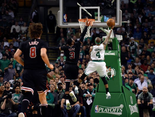 Boston Celtics guard Isaiah Thomas (4) lays the ball