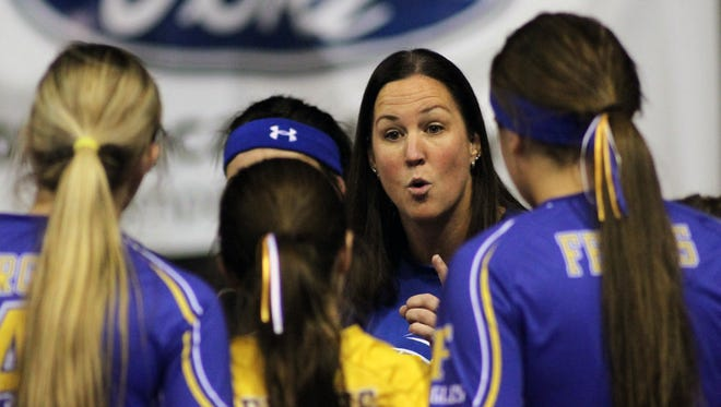Tara Taylor, head volleyball coach at Lewistown's Fergus High School (center, facing camera), has stepped down after 16 seasons as the team's mentor and 22 years with the program, the school announced Wednesday.