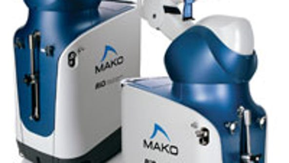 The Mako robotic arm that allows local surgeons to