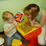 """Speech therapist Martha Reeves works with Carson Ross, 3, on making """"s"""" sounds at the Scottish Rite Childhood Language Disorders Clinic."""