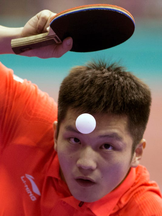 FILE- In this March 1, 2016, file photo, China's Fan Zhendong prepares to serve against Czech Republic's Tomas Konecny during the men's team table tennis championship in Kuala Lumpur, Malaysia. China's overwhelming domination of table tennis at the Olympics will likely continue in Rio, but there's drama about just which member of the fantastically talented Chinese national team will prevail. (AP Photo/Vincent Thian, File)