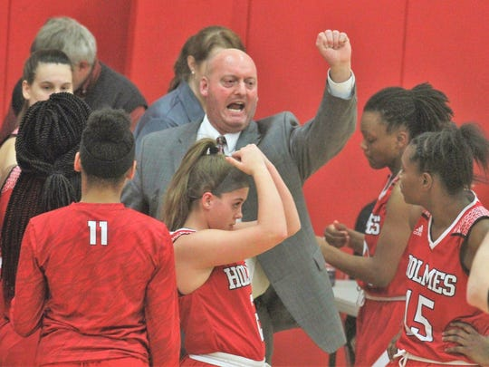 Holmes head coach Greg Ash rallies his team during Holmes' 76-30 girls basketball win over Beechwood Jan. 31, 2018 at Beechwood High School, Fort Mitchell KY.