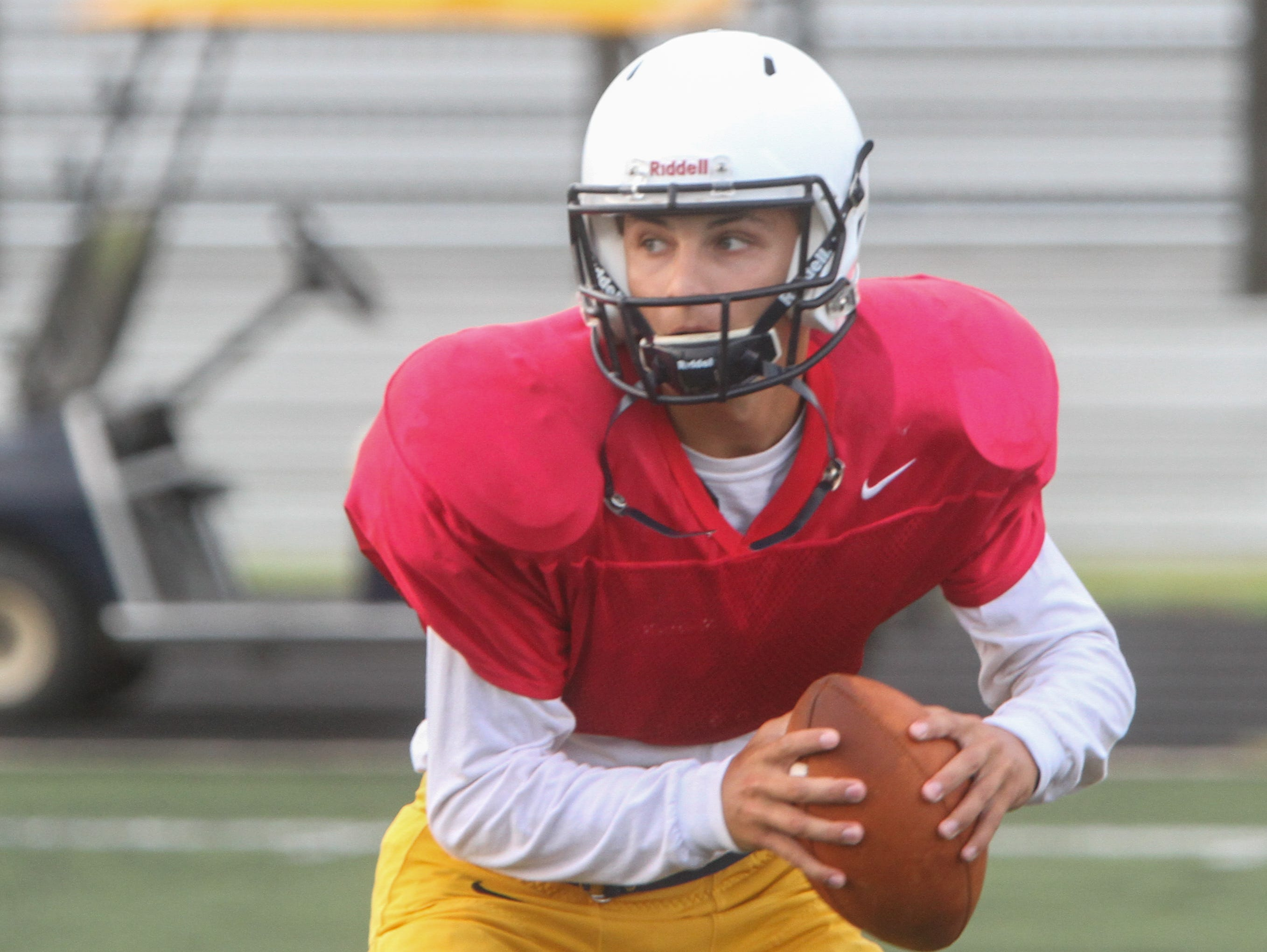 TOM SPADER/STAFF PHOTOGRAPHER Toms River North's Mike Husni looks to pass for Toms River North during practice in the 2015 season Toms River, NJ QB Mike Husni - during Toms River High School North pre season football practice. 081915