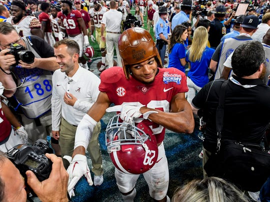 Alabama defensive back Minkah Fitzpatrick (29) wears the old leather helmut after Alabama defeated Florida State in the Chick-fil-a Classic at the Mercedes - Benz Stadium in Atlanta, Ga., on Saturday September 2, 2017. (Mickey Welsh / Montgomery Advertiser)
