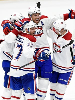 Montreal Canadiens defenseman Shea Weber (6) celebrates with teammates after scoring a goal against the Nashville Predators during the third period of an NHL hockey game Tuesday, Jan. 2, 2017, in Nashville Tenn. The Canadiens Won in overtime 2-1.