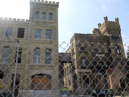 This Sept. 3, 2015 photo shows the former Pabst bottling plant, both built with Cream City bricks, under renovation in Milawukee. The left building, with cleaned bricks, shows a prized find for developers inclined to clear away decades dark stain from buildings revealing Milwaukee?s once-forgotten signature. (AP Photo/Greg Moore)