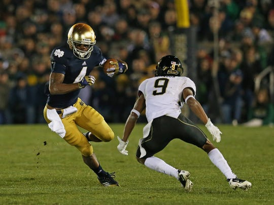 Wake Forest defensive back Kevin Johnson closes in on Notre Dame'George Atkinson II during a 2012 game in South Bend, Ind.