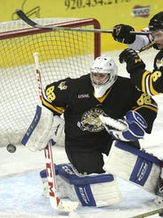 Green Bay Gamblers goalie Adam Huska (82) appeared