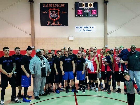 Linden police officers and firefighters played a Battle