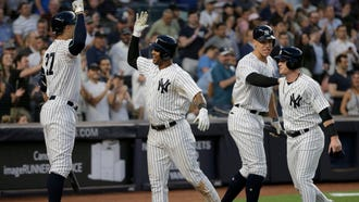 New York Yankees' Aaron Hicks, second from left, celebrates his two-run home run with teammates Giancarlo Stanton, left, Aaron Judge, second from right, and Clint Frazier during the fifth inning of a MLB baseball game against the Seattle Mariners at Yankee Stadium Tuesday, June 19, 2018, in New York.