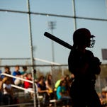 A Port Huron player stands on deck during a softball game at Marysville High School.