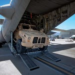 An Oshkosh Corp. JLTV leaves an air transport cargo bay.