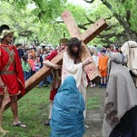 The Golden Pond Spiritual Center presents Living Stations of the Cross on Good Friday on the levee at Forsythe boat dock. In this photo from 2014, actors portray Roman soldiers, Christ and his followers.