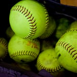 A bag is filled with softballs during practice Friday, March 27, 2015 at Port Huron High School.