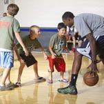 Utah Jazz forward Jeremy Evans, teaches basketball principles to area youth as part of the Junior Jazz Road Trip stop at the St. George Recreation Center.