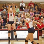 Dixie State setter Kailey Avery sets the ball for middle blocker Nicole Koehler on Sept. 19.
