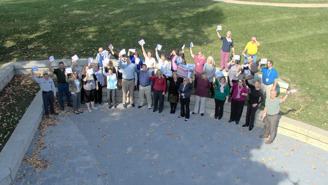 Livingston County government employees pose for a drone selfie as part of their United Way campaign on Wednesday.