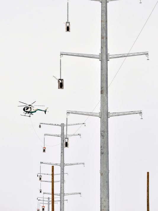 636017809214104474-Helicopter-power-line-1.jpg