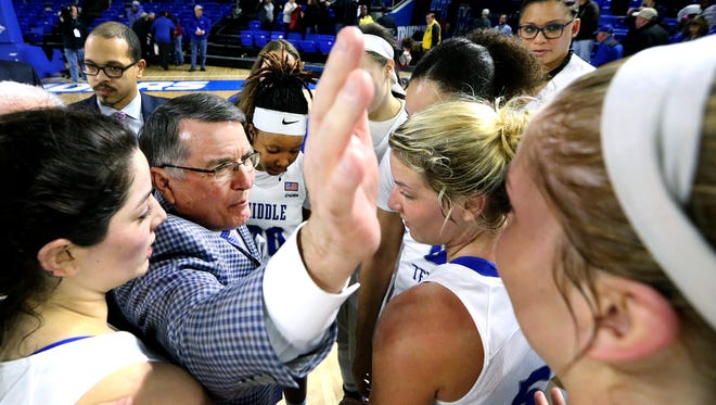 MTSU's Head Women's Coach Rick Insell celebrates the 77-63 victory over UTSA after the game with his team on Thursday, Feb. 2, 2017.