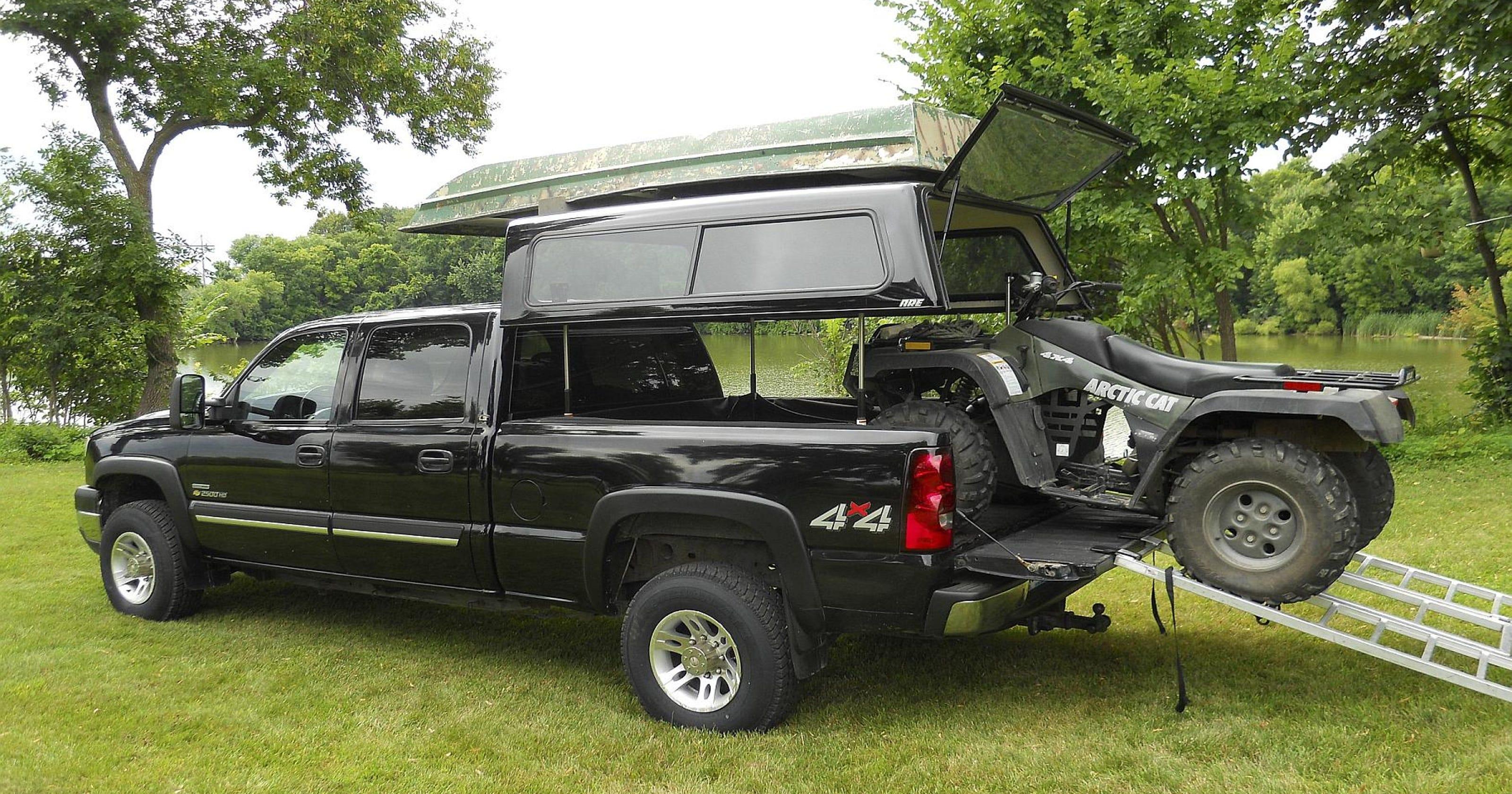 EZ lift lets truck bed cap rise, convert to camper