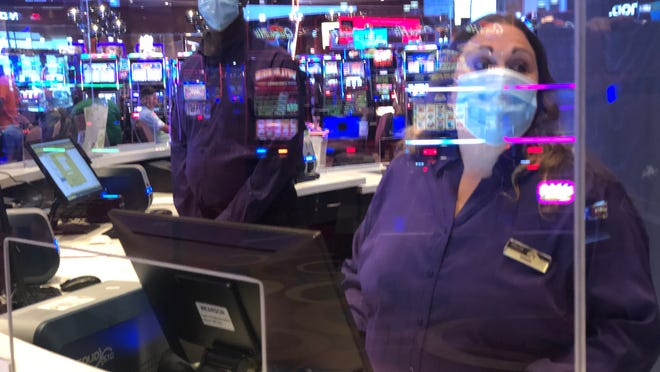 MGM Northfield Park employees wear masks and stand behind a protective shield as part of the COVID-19 protections in place.