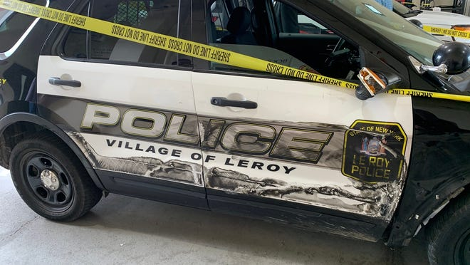 """This LeRoy Police Department vehicle was rammed by a tractor-trailer on West Main Street in LeRoy on Wednesday. The driver, stopped for speeding, drove off and led police on a chase that spanned three counties. The driver, who exchanged """"a lot"""" of gunfire with police, was killed."""