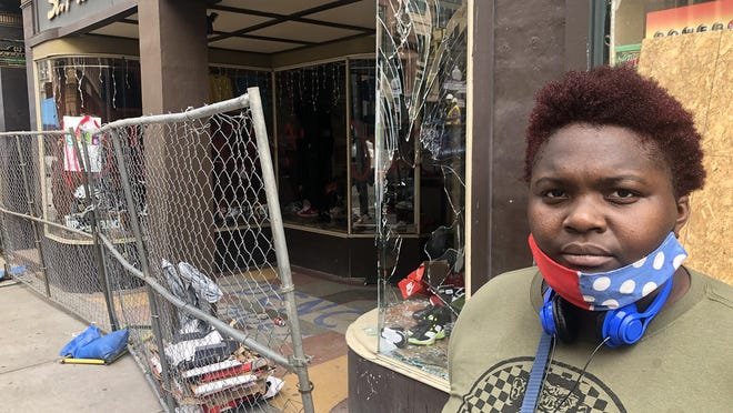 """Brittany Reid, who said she's a """"lunch lady"""" at a Providence charter school, was downtown Tuesday volunteering with the cleanup."""