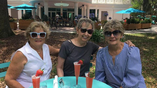 From left, Mayette Sims, Marcia Thompson and Amanda Cannon take a break from their walk downtown.