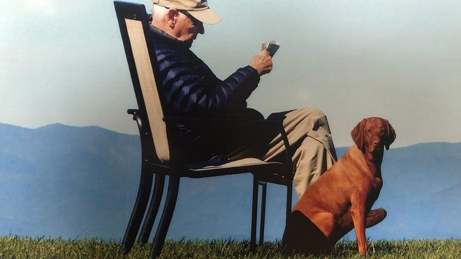 Mitchell Dunn is shown in his favorite place in the whole world, a relaxing spot where he could sit in a chair and toss a ball to his dog, Ruby. Retired  from HunterMaclean, attorney Dunn died Sept. 6 at the age of 89.