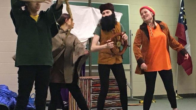 Members of the Savannah Children's Theatre, Alexandra Blanco, Eowyn Miller, Taylor Rigsbee and Natalie Barker, practice for a short play with basic costumes and set design.
