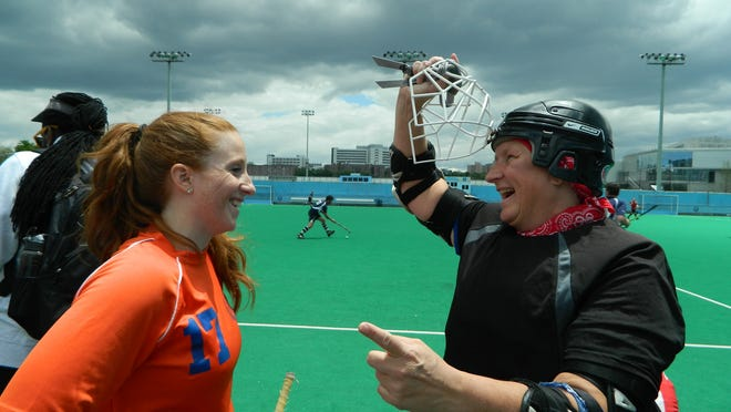Beth Denmead of Netcong (right) talks to New York Islanders teammate Ava DeGori after a North East Field Hockey Association game.
