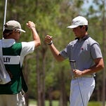 Davis Riley, of Hattiesburg, Miss, fist bumps his caddie T.Jay Fairlie at the 13th hole of the Terra Cotta Invitational.