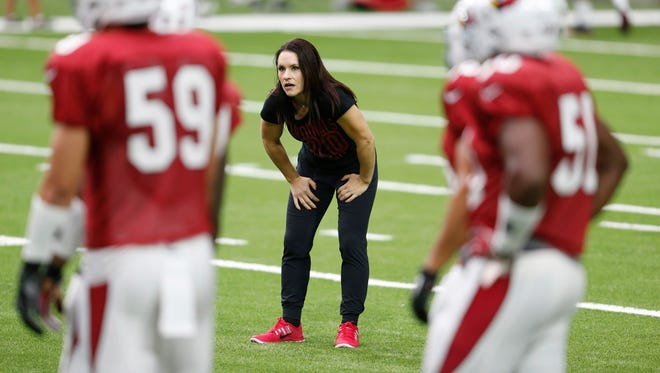 Arizona Cardinals training camp intern coach Jen Welter works with inside linebackers during practice at University of Phoenix Stadium in Glendale on Aug. 26, 2015.