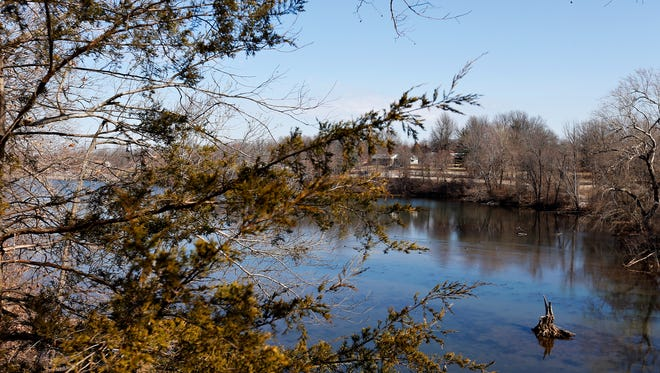 With unseasonably warm temperatures this month, the trail overlooking the pond at Valley Water Mill Park is a popular choice for outdoor recreation in Springfield.