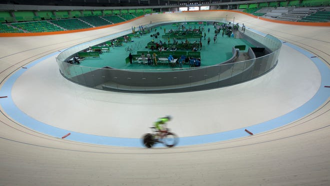 A cyclist rides his bike during a test event at the new velodrome, the last venue of the Rio 2016 Olympic Park to be delivered, in Rio de Janeiro, Brazil, Sunday, June 26, 2016.