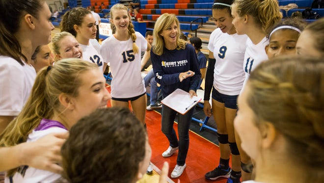 Desert Vista High volleyball coach Molly West talks to her players before a match against Mountain View High in Mesa on Sept. 7, 2016.