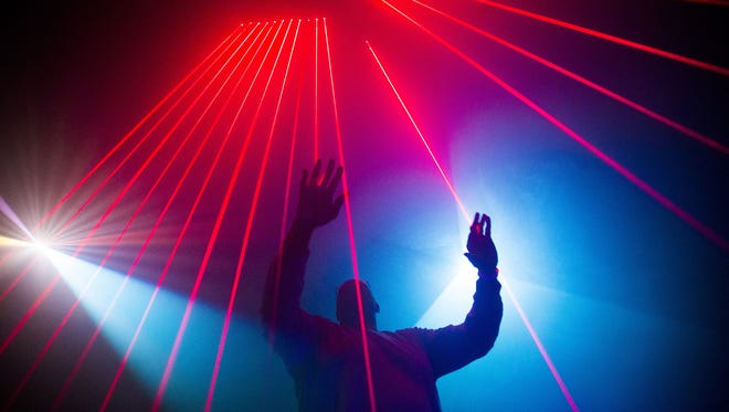 Arizona Republic reporter Weldon Johnson plays with lasers at Meow Wolf in Santa Fe, New Mexico. Meow Wolf is an interactive art play space.