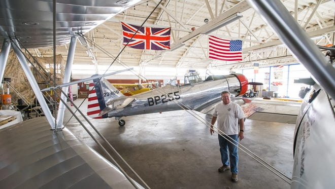 Dale Churchill, founding member of the Wings of Flight Foundation, walks around their hangar at Falcon Field in Mesa on April 4, 2017. Mesa is evicting the World War II aviation non-profit in favor of a business that brings more jobs.
