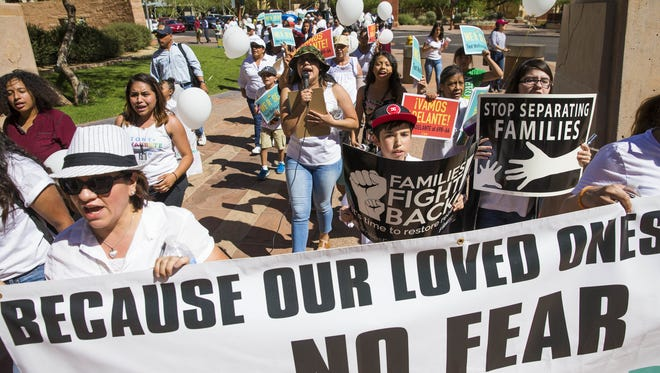 Protesters march towards Phoenix City Hall April 30, 2017. Promise Arizona held a march made-up of mostly teens and children who were marching with the goal of keeping families together.
