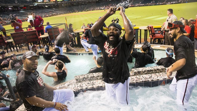 Arizona Diamondbacks closer Fernando Rodney (center) celebrates in the pool with teammates after clinching a playoff berth at Chase Field in Phoenix, Ariz. September 24, 2017.