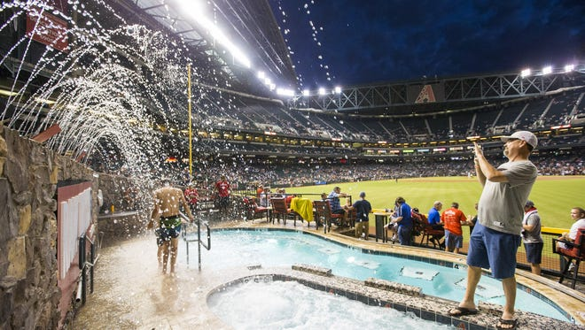Bob Interdonato takes a picture of the fountains near the pool while attending a game between the Arizona Diamondbacks and San Francisco Giants at Chase Field in September 2017.