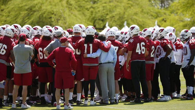Arizona Cardinals players huddle during a voluntary three-day mini camp at their Tempe training facility April 17, 2018.