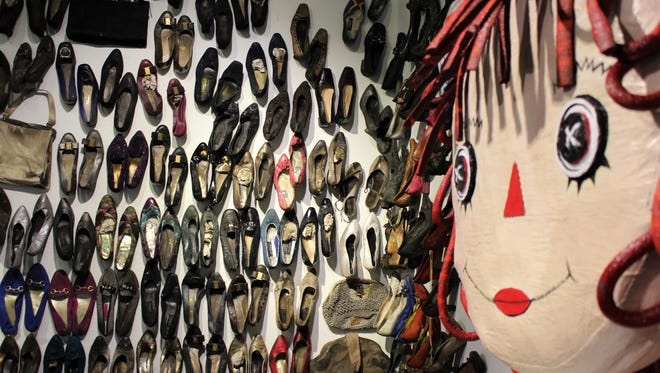 """""""Rags,"""" a piece by Kacy Latham, curator of the new """"RePlay: Storybook Attic"""" exhibit at the Center for Contemporary Arts,"""" stands watch over an exhibit filled with shoes upstairs at the downtown Abilene gallery."""