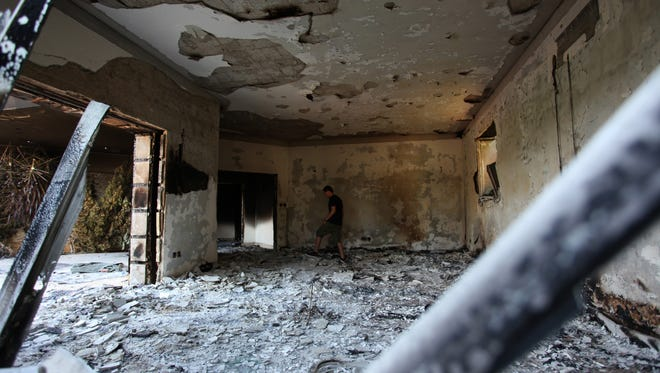 In this Sept. 13, 2012, file photo, a Libyan man walks in the rubble of the damaged  U.S. consulate, after an attack that killed four Americans, including Ambassador Chris Stevens, on the night of Tuesday, Sept. 11, 2012, in Benghazi, Libya.