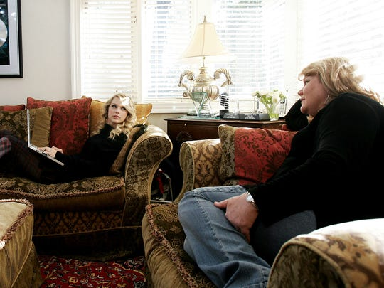From 2008: Taylor Swift talks with her mom Andrea as she checks emails on her laptop in the living room of the home she shares with her parents in Hendersonville, Tenn.