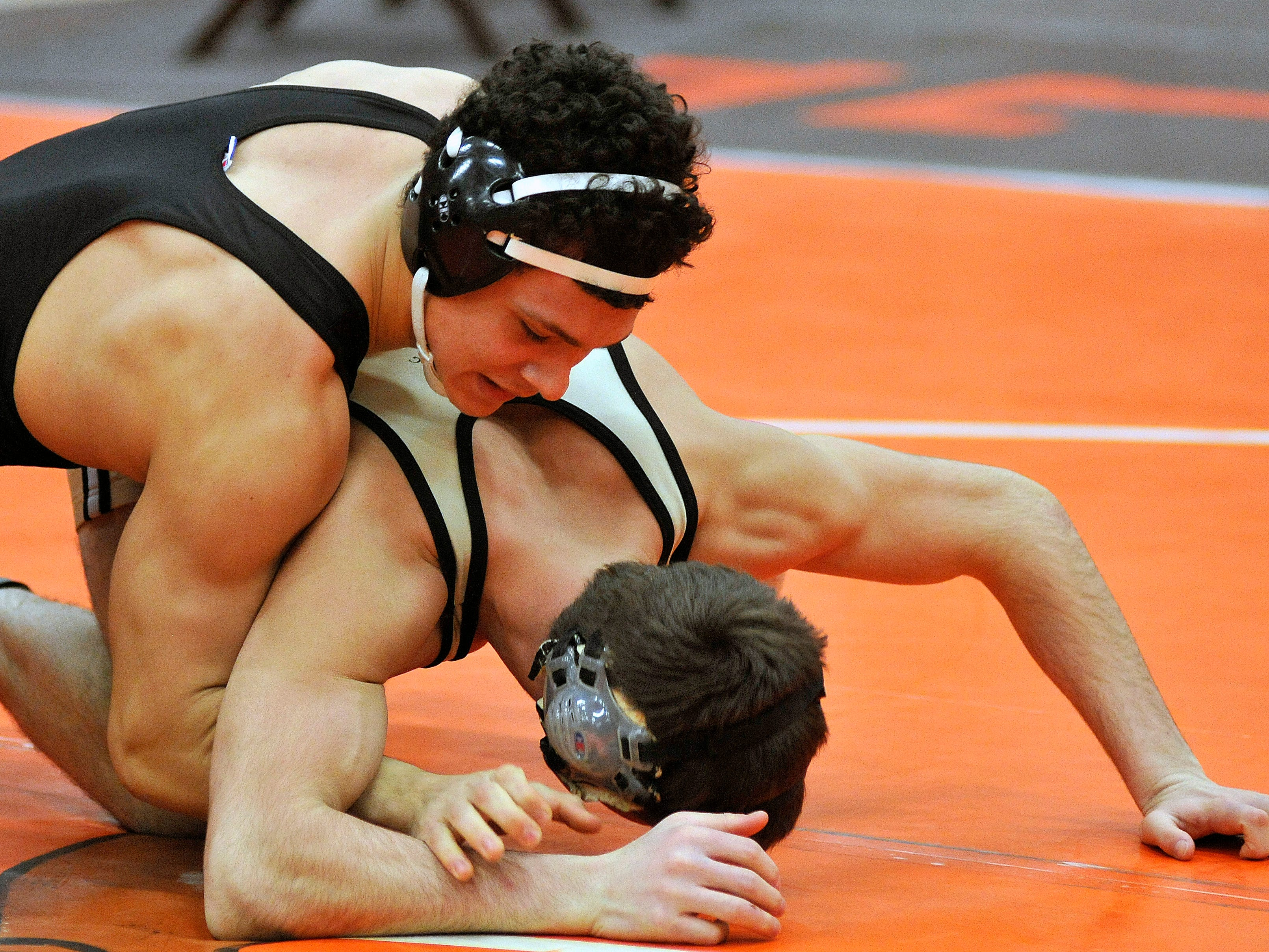 Mansfield Senior's Jesse Palser, the No. 1-ranked 170-pounder in the state, pinned his way to a repeat title in Saturday's Division I sectional meet in Pete Henry Gym. In this match, Palser pinned Perrysburg's Matt Waltermeyer in 1:24.