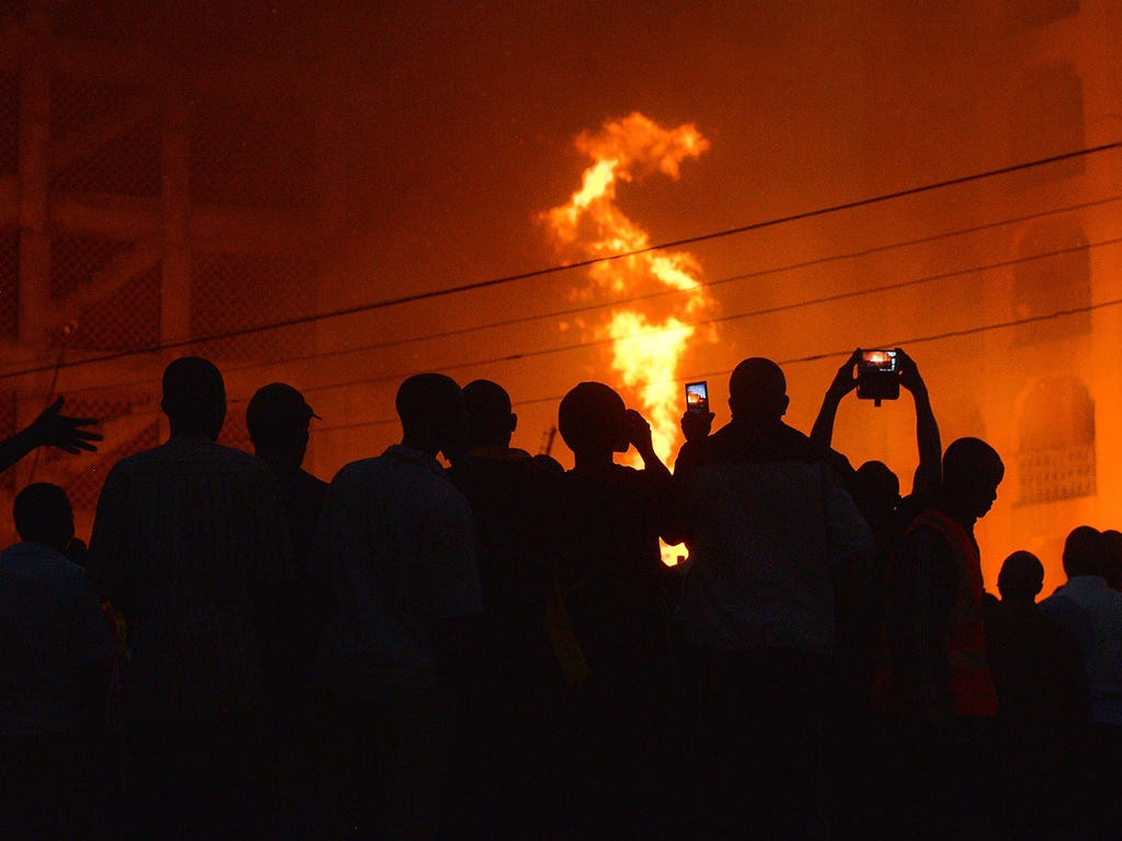 People photograph a fire with their mobile phones on March 9 in Nairobi, Kenya.
