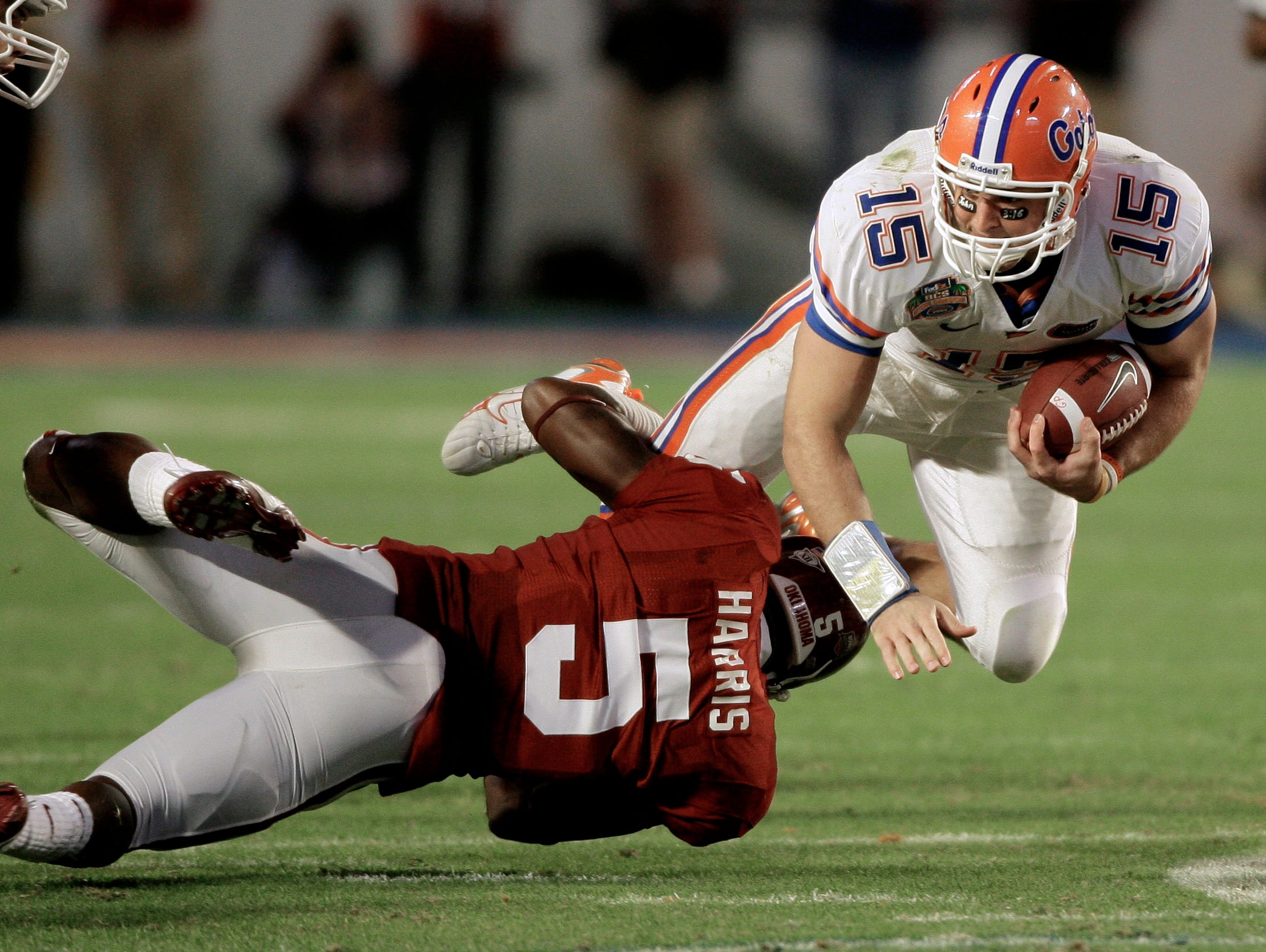 Florida quarterback Tim Tebow (15) is stopped by Oklahoma's Nic Harris (5) during the third quarter of the BCS Championship NCAA college football game in Miami, Thursday, Jan. 8, 2009. (AP Photo/Chris O'Meara)