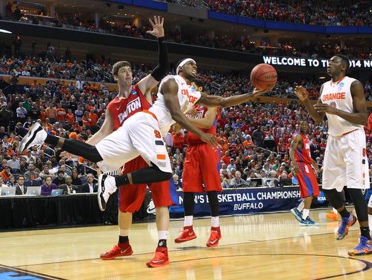 Syracuse's C.J. Fair drives hard to the basket against